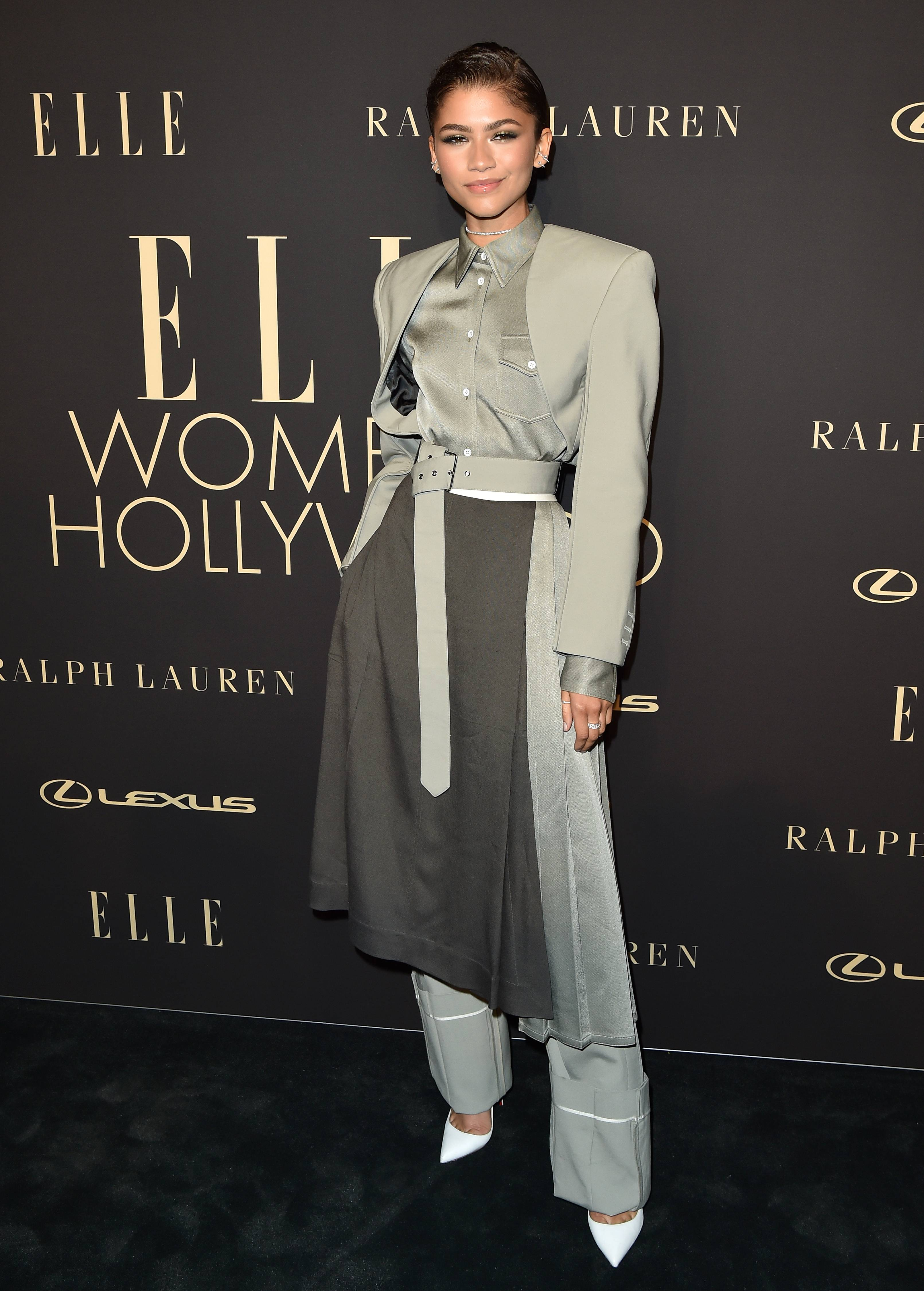 Shades of Z - Zendaya brought grey to life and we're here for it! She killed Elle's Women in Hollywood event wearing aSS 2020, off the runway, grey, pantsuit ensemble byPeter Do. Styled by Law Roach, she paired the look with her favorite, white, Louboutin 'So Kate' pumps ($780) and jewelry byYvan Tufenkjianjewelry.(Photo: Axelle/Bauer-Griffin/FilmMagic)
