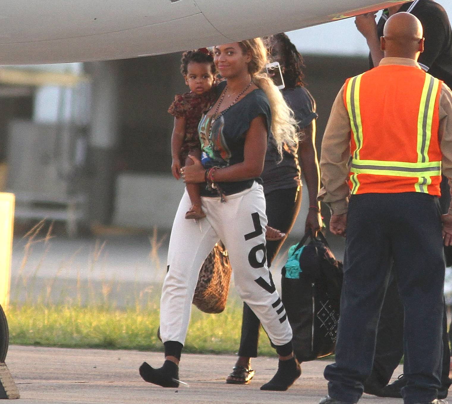 World Travel - After a stint in Brazil, Beyonce headed to Puerto Rico with baby girl Blue Ivy in her arms. Bey's hair is back and Blue Ivy is racking up stamps on her passport before adulthood. That's the life!(Photo: GV Cruz/WireImage)