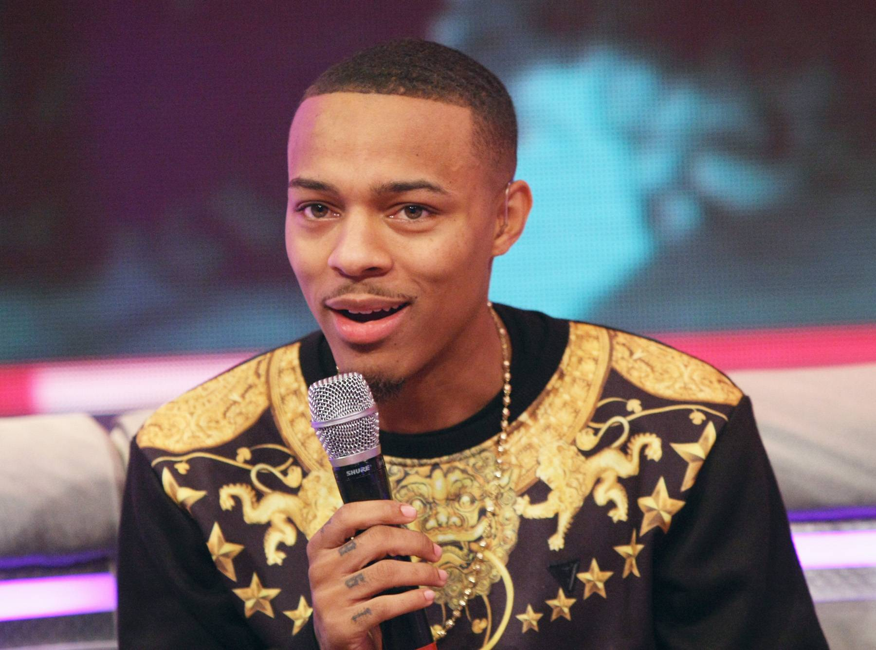 Sly - Host Bow Wow gives a sly laugh while on set.(Photo: Bennett Raglin/BET/Getty Images for BET)