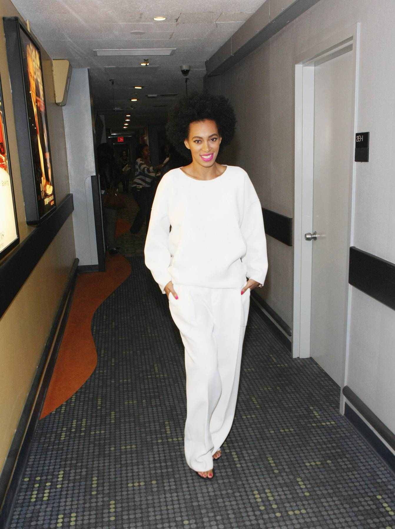 Solo - No need for a grand entrance, Solange enters and people watch her style.