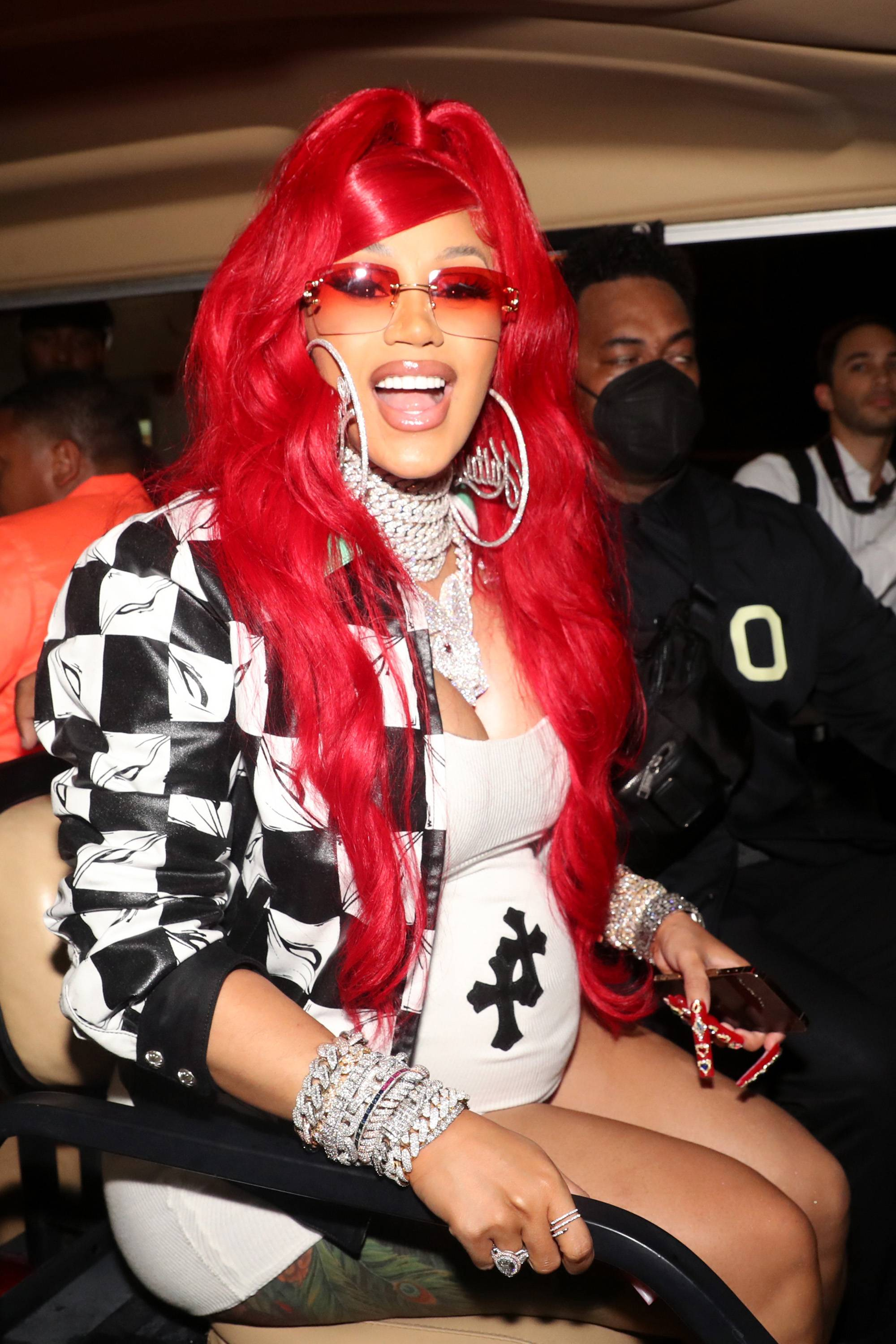 Hot 97's Summer Jam 2021 - Cardi Bshowed off her growing baby bump while performing with her husbandOffsetand rap groupMigosat Hot 97's Summer Jam 2021. Behind the scenes, the pregnant rapper snapped this photo rocking a short T-shirt dress with a black-and-white checkered bomber jacket. The Bronx native completed her look with bright red hair and layers of diamond bling.This makes baby no. 2 for Cardi and Offset, who welcomed their daughterKulturein 2018.We can't wait to see how the lovebirds celebrate their new addition. We also can't wait for more music and style from Cardi this year.(Photo by Johnny Nunez/WireImage) (Photo by Johnny Nunez/WireImage)
