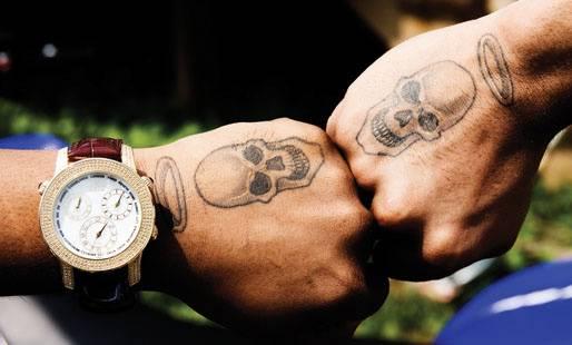 Skulls - Twin skulls with halos adorn his hands.   (Photo: Chris Brown via Twitter)