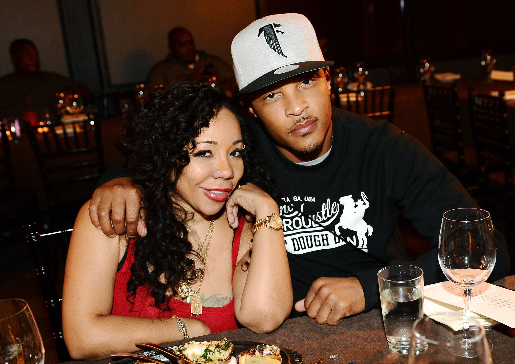 """Tiny and T.I. - T.I. and Tiny have been labeled the """"Hip Hop Huxtables"""" by the masses and for good reason. Now, in the second season of T.I. & Tiny:The Family Hustle, the world has officially fallen in love with the Harris family. Despite whatever preconceived notions folks have had about T.I., his love, dedication and support that he gives to his family make him quite possibly one of the most lovable fathers out there. Oh, and this couple is S-E-X-Y! (Photo: Rick Diamond/Getty Images)"""