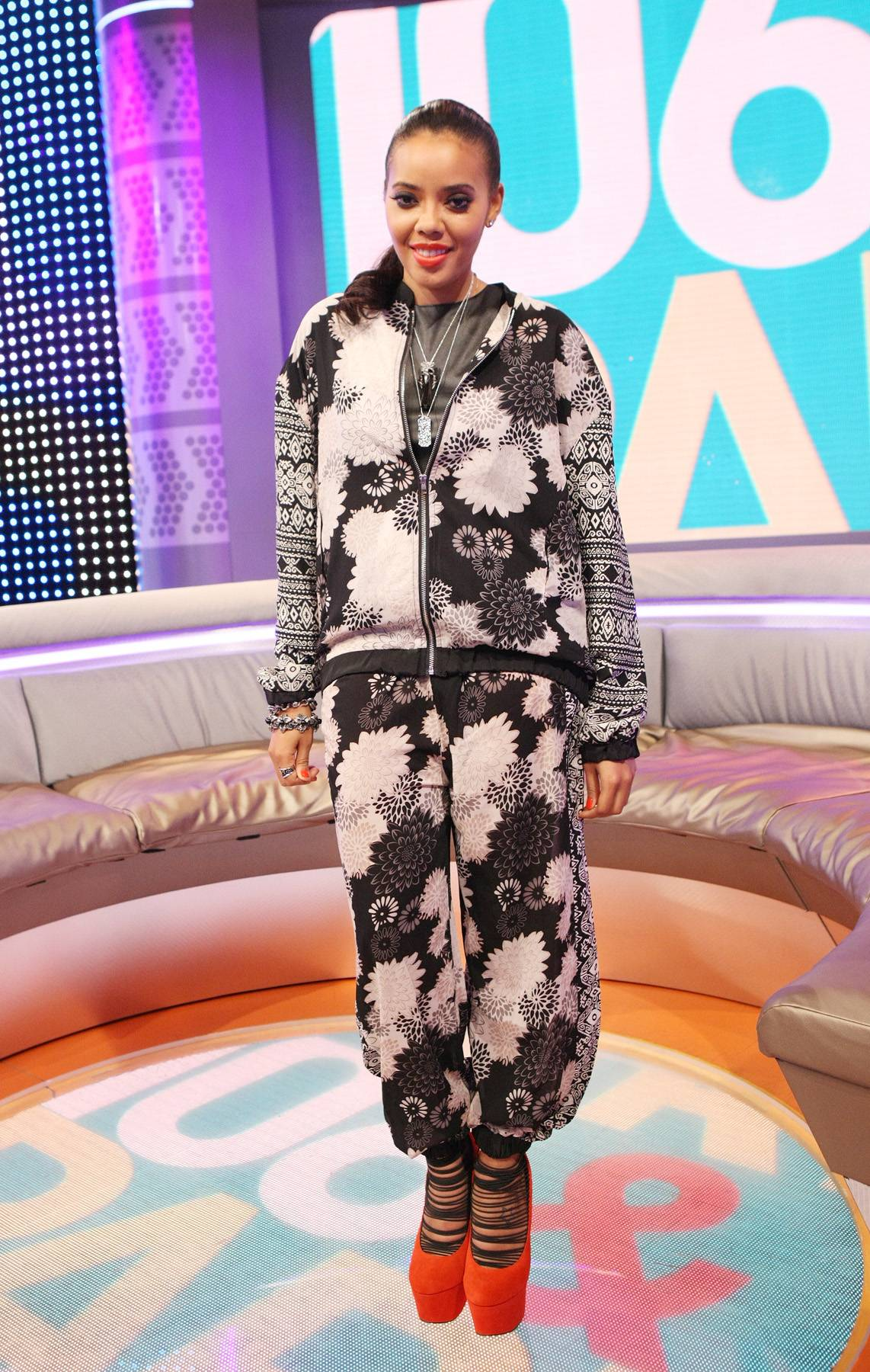 Work Out Plan - With a dope red shoe and a floral and tribal print black-and-white sweat suit, Angela dresses up a casual outfit and put us on to a new trend. (Photo: Bennett Raglin/BET/Getty Images for BET)