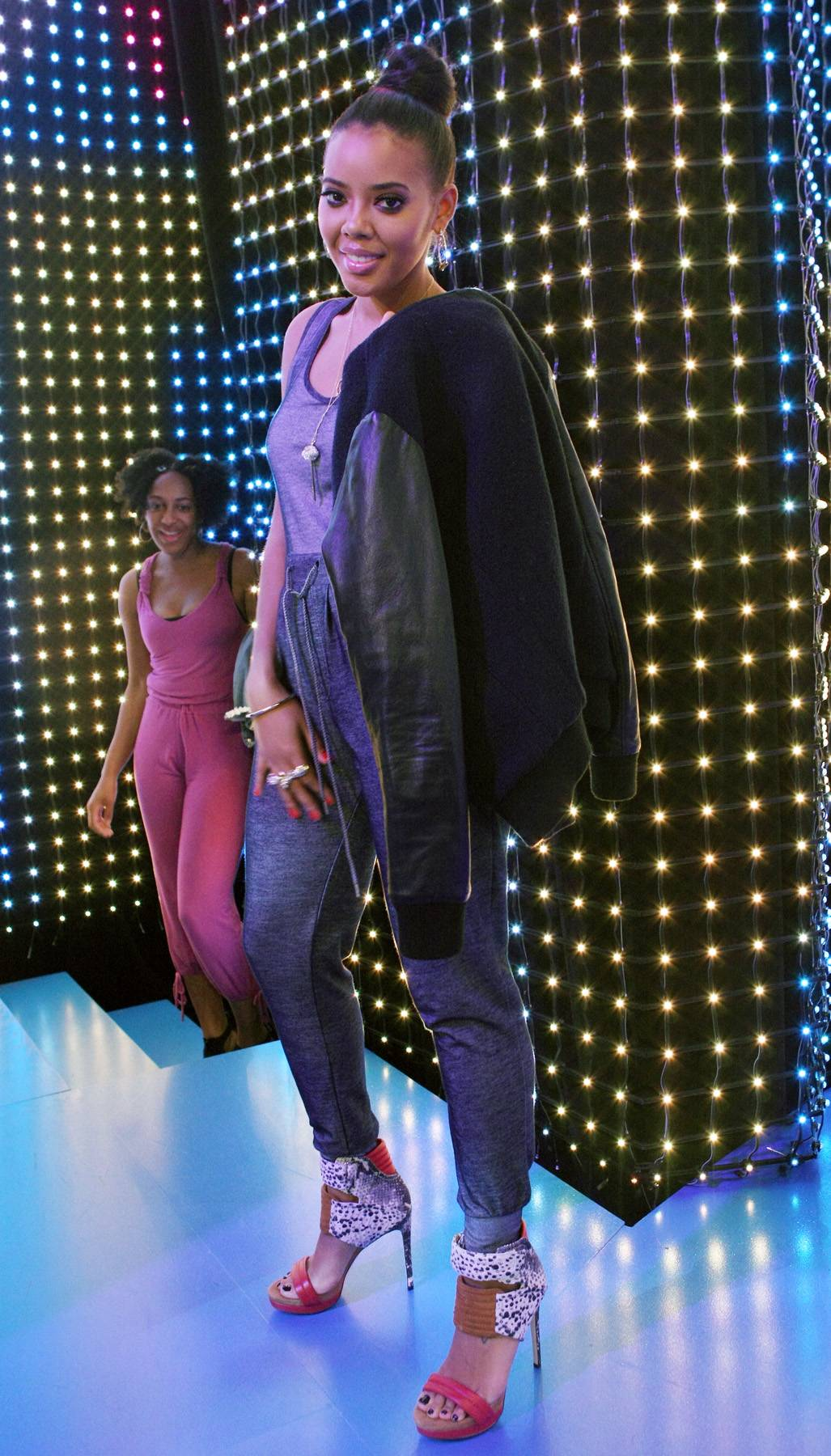 '90s Chic - Angie Simmons poses near the 106 stage spotlight. (Photo: Bennett Raglin/BET/Getty Images for BET)