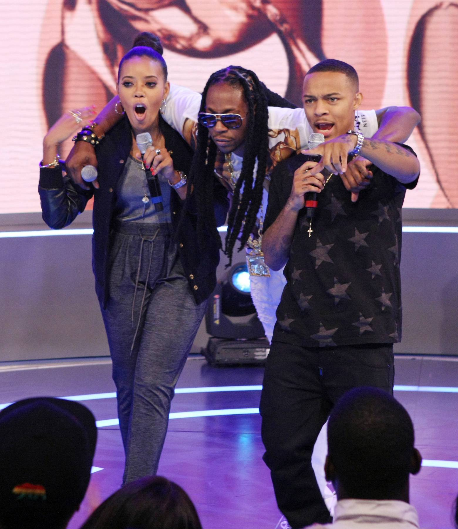 Whoa! - Angela Simmons, 2 Chainz and Bow Wow hug it out on the 106 stage. (Photo: Bennett Raglin/BET/Getty Images for BET)