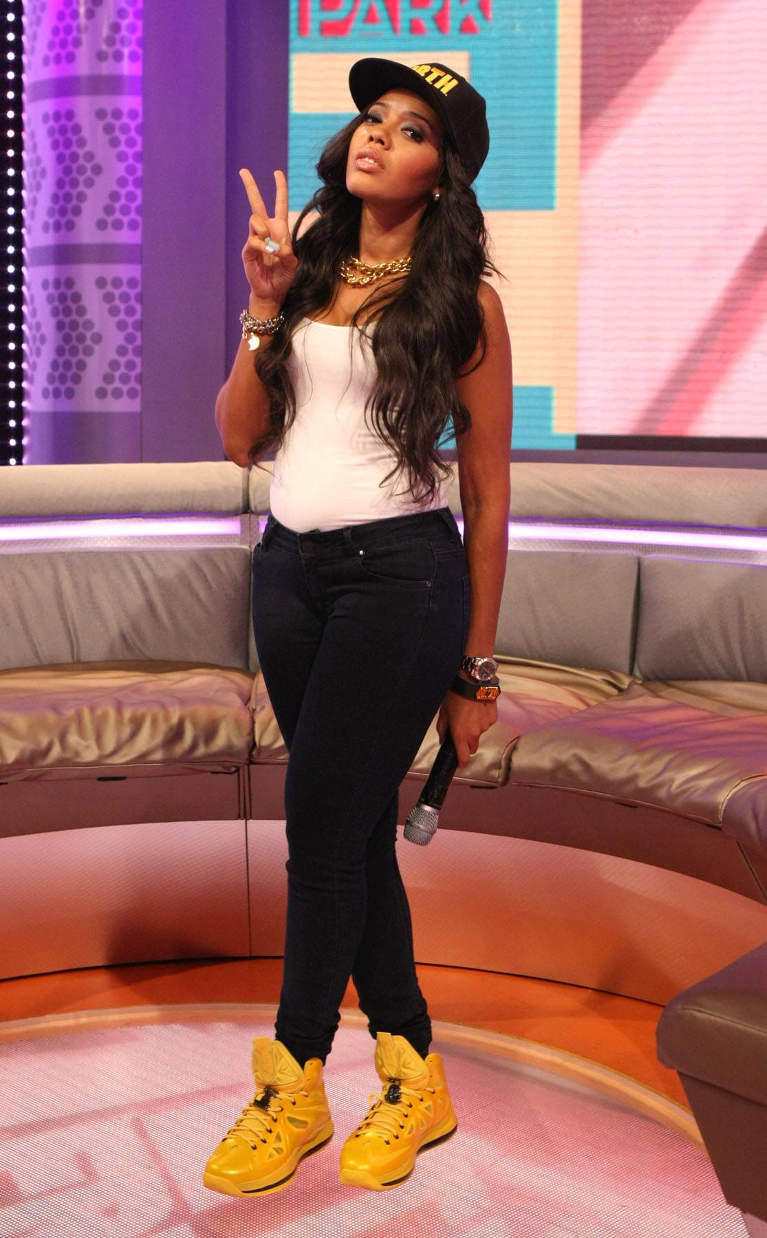 Keep It Hood - Host Angela Simmons throws the deuces on 106. (Photo: Bennett Raglin/BET/Getty Images for BET)