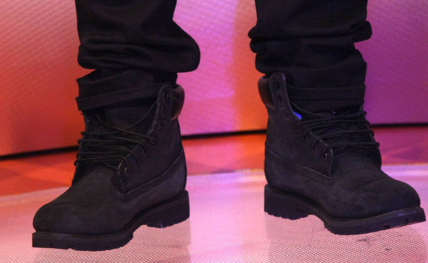 Rugged - Bow Wow rocks some all Black boots on 106. (Photo: Bennett Raglin/BET/Getty Images for BET)