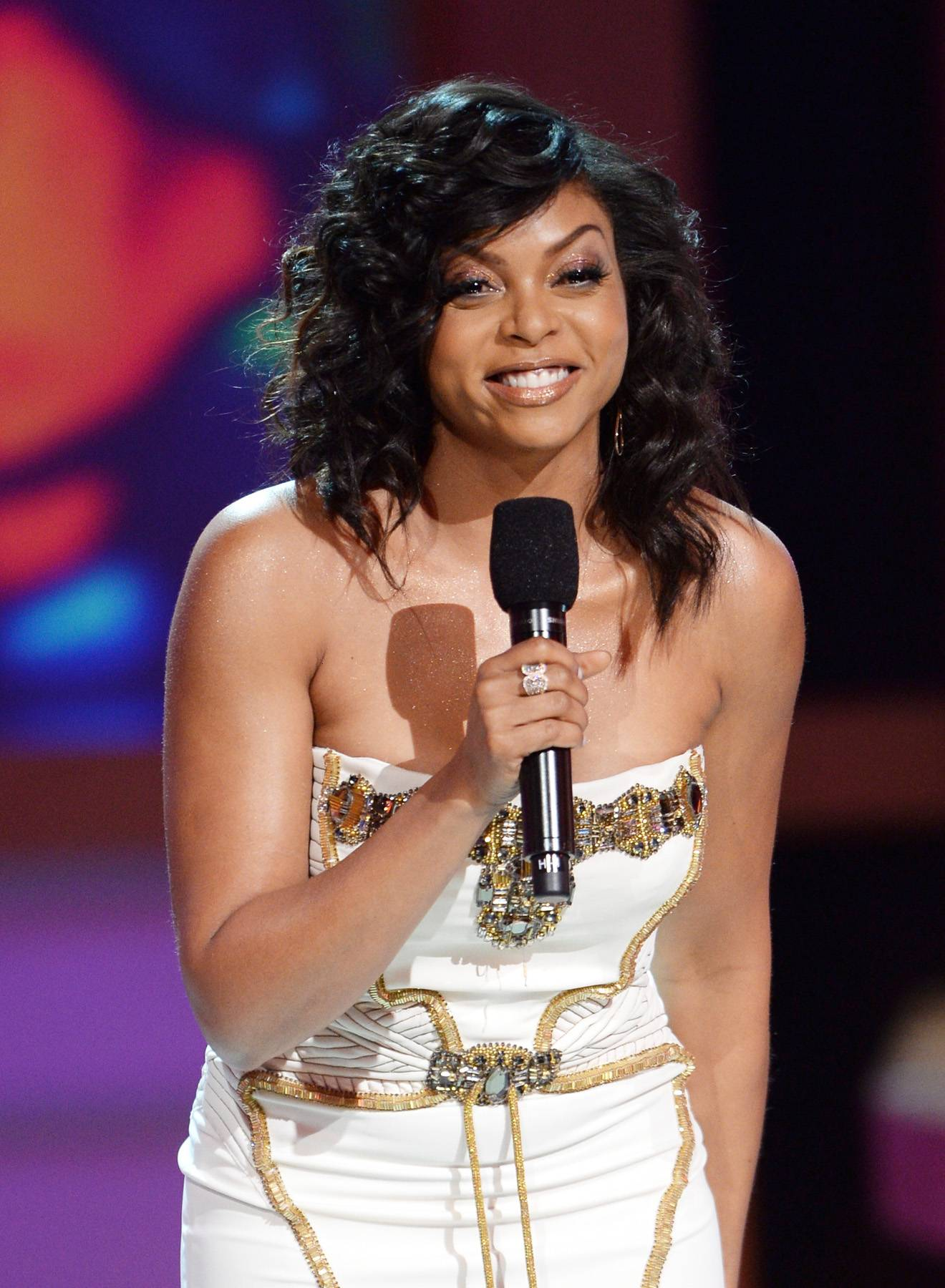 """Taraji's Testimony - After dishing on taking the hosting torch from Steve Harvey, Taraji shares her testimony of journeying to L.A. from D.C. with seven hundred dollars, her son and Jesus. It's safe to say she """"started from the bottom now she's here.""""(Photo: Jason Kempin/Getty Images for BET)"""