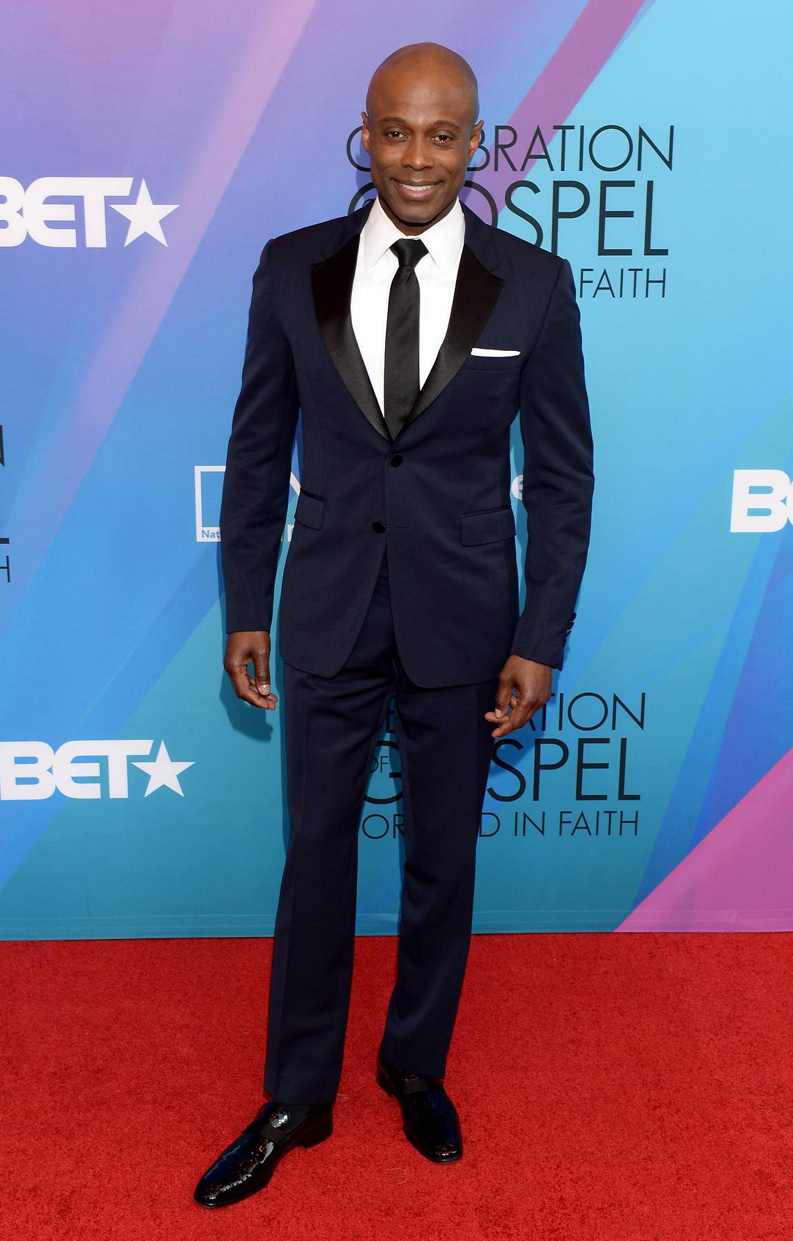 Soul Man - Soul singer Kem brought classic Hollywood chic to this year's Celebration of Gospel red carpet in a perfectly tailed navy blue tux.(Photo: Jason Kempin/Getty Images for BET)