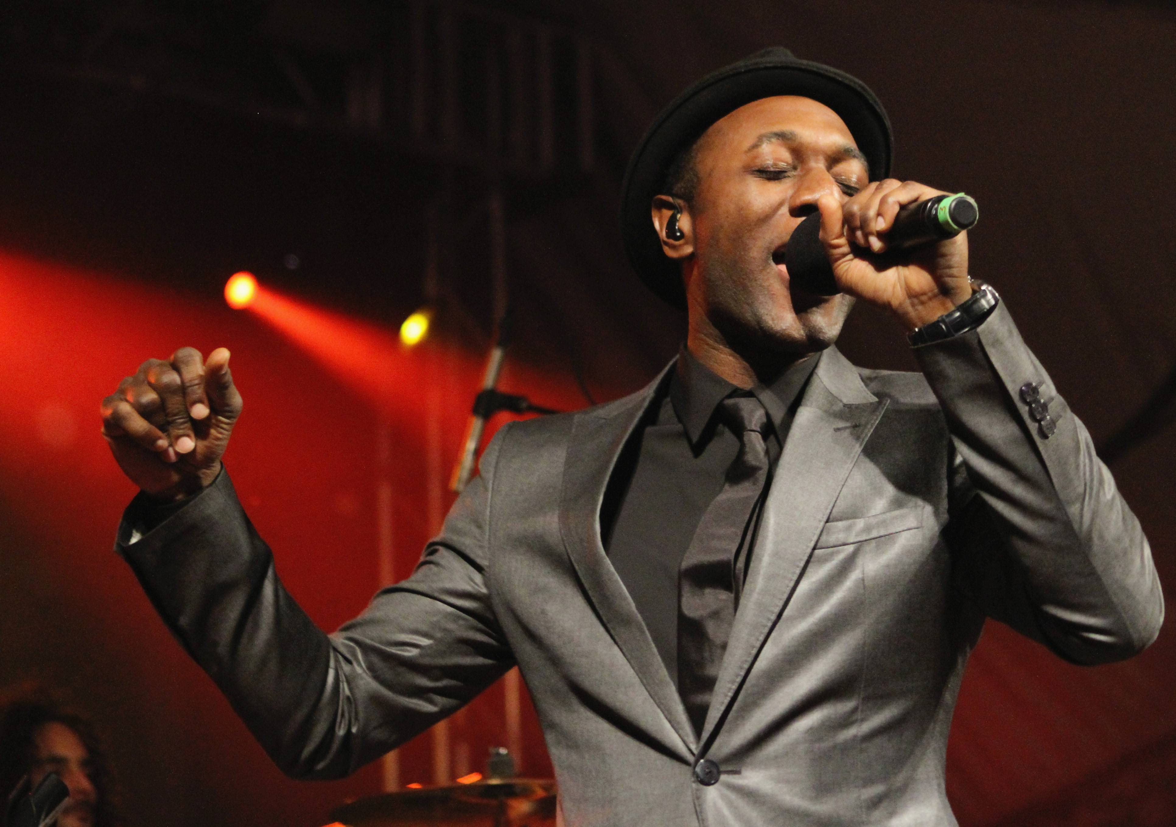 """Lifting Spirits - It never rains when Southern California crooner Aloe Blacc is on the mic. He performed several showcases, showing off his new song, """"The Man,"""" from his third studio album, Lift Your Spirit.(Photo: Travis P Ball/Getty Images for SXSW)"""