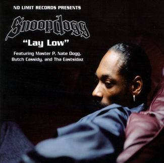 """Snoop Dogg featuring Master P, Nate Dogg, Butch Cassidy and Tha Eastsidaz, """"Lay Low"""" - In yet another tone-setting appearance, Nate gets gangsta again on this Snoop and Master P collaboration, where he warned, """"I hope he don't be thinkin' I'm just talkin' and I won't do a thing/Really hope so...""""(Photo: No Limit Records)"""