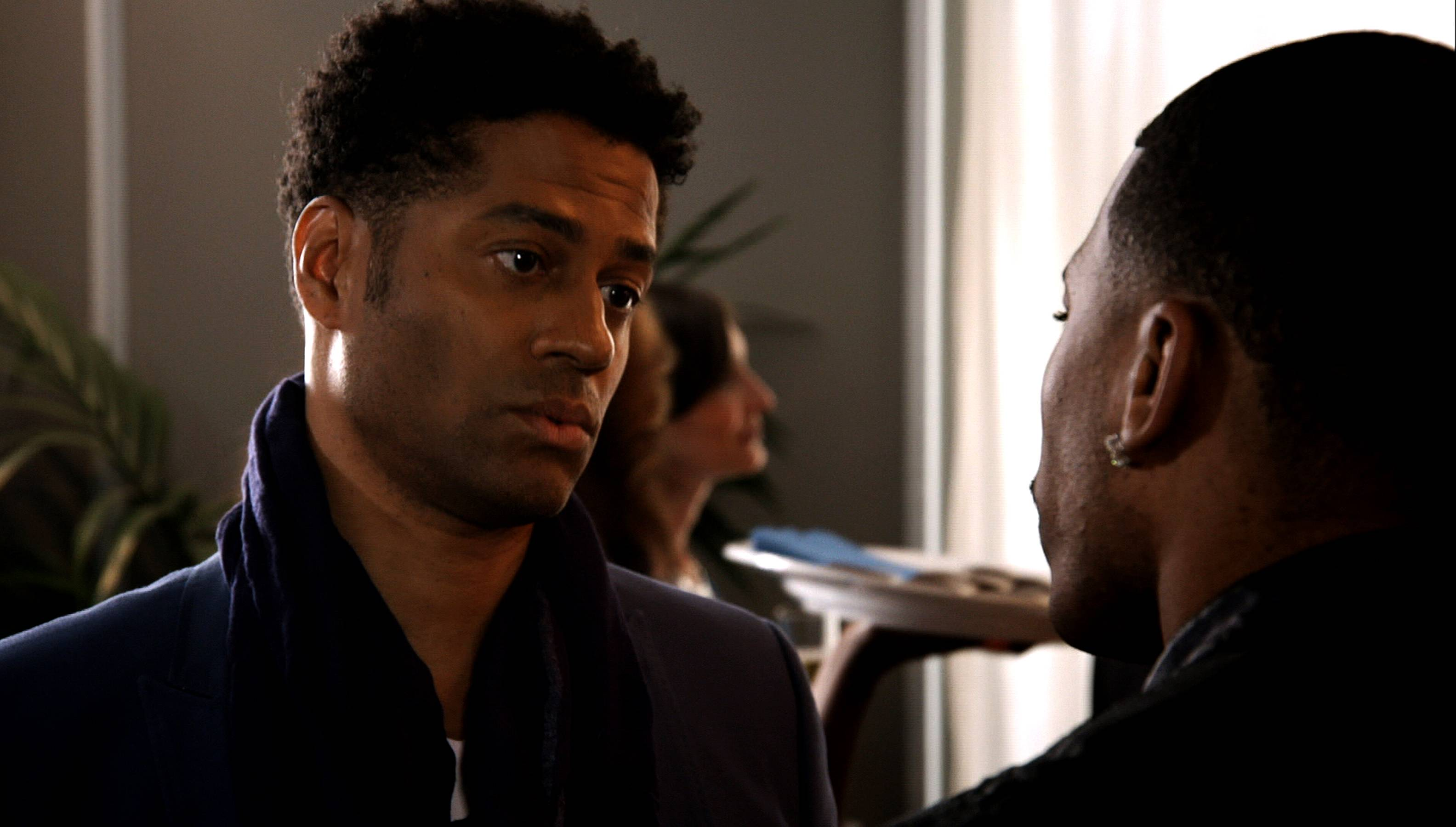 Benet's Business - Eric Benet strikes up some business with Nelly. Little does Nelly know that this business proposition might be a bit difficult to fulfill.(Photo: BET)