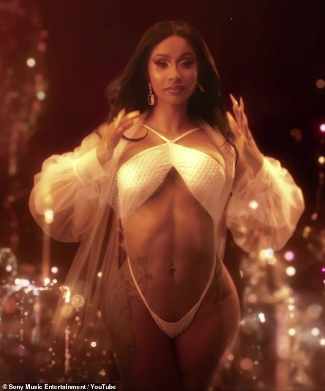Spicy Mami, Hot Tamale - Cardi B's visuals stay on point! The detail in every video, outfit, and scene seems to be perfectly executed. Her latest execution was with Post Malone and French Montana in their 'Writing On The Wall' video. Cardi B's outfits were stunning, as she showcased her fit physique in sheer bikinis and lacey lingerie. (Photo: Sony Music Entertainment via Youtube)
