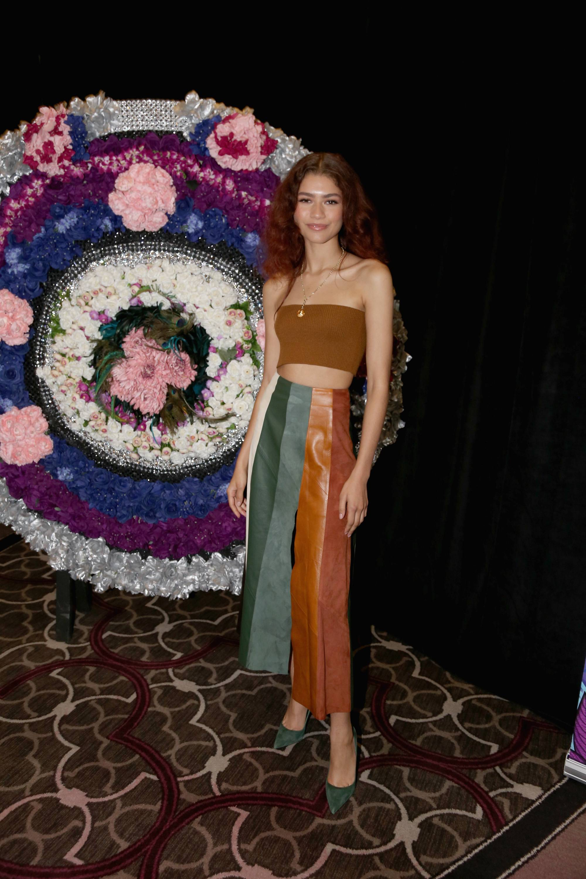 Forever Ferragamo - HBO's Euphoria star dazzled the crowd with her charm and trendsetting style at the AT&T Dream in Black invite-only brunch at the 25th Essence Festival. She wore a multi-colored patchwork Ferragamo Skirt and ribbed tube top along with suede forest green pumps by LaSilla styled by her longtime stylist Law Roach. (Photo: Gary Miller/WireImage)
