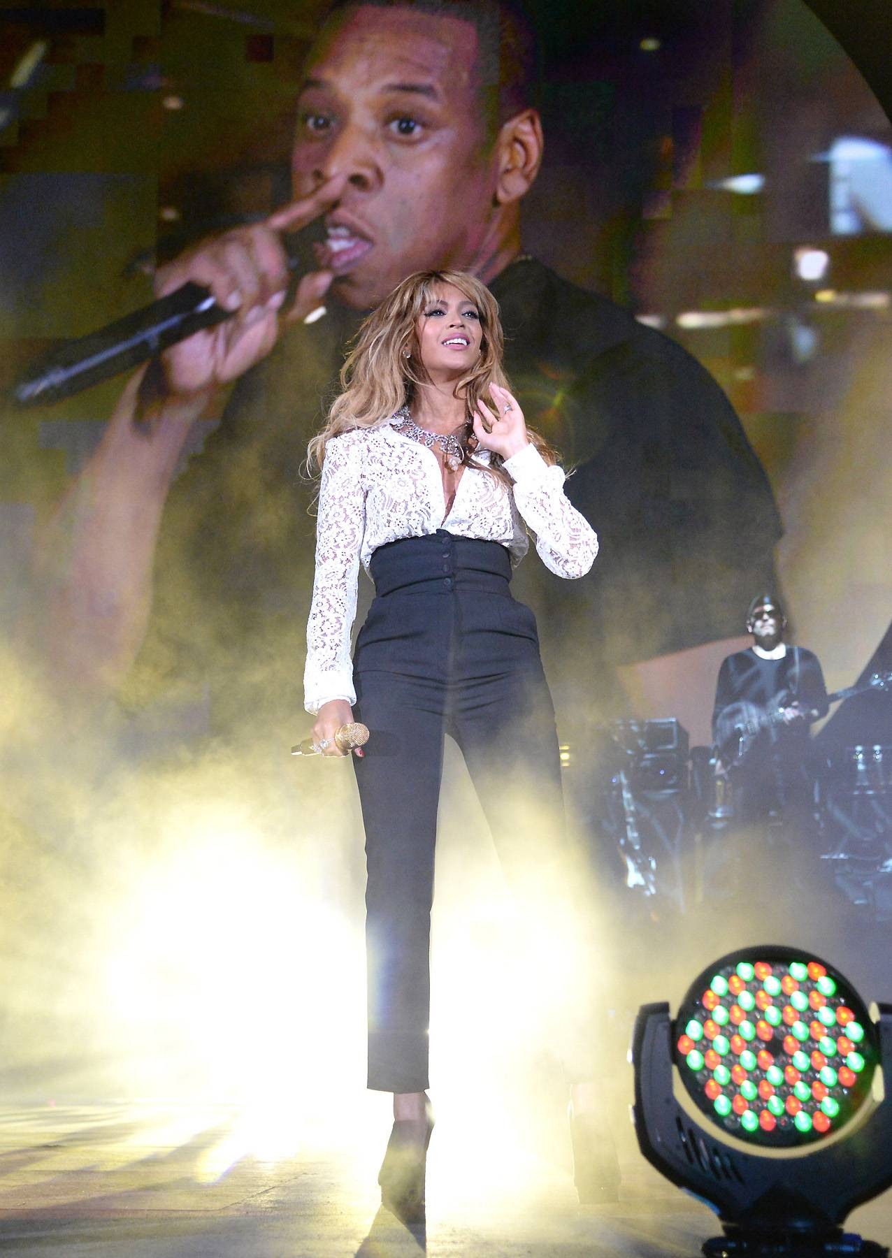 """Global Citizen Festival - It's funny how the Carters are now known for surprises, but the shock factor never gets old. The couple gave attendees at New York City's Global Citizen Festival a special treat when Hov brought out his other half to perform """"Holy Grail"""" and """"Young Forever.""""(Photo: Kevin Mazur/Getty Images for Global Citizen Festival)"""