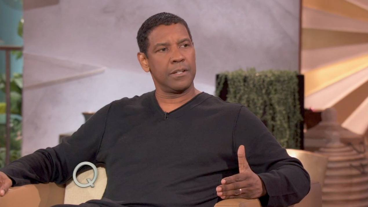 """Denzel Impersonates Jigga - Denzel Washington is a stellar actor, so it shouldn't be a surprise that he does a pretty good impression of Jay Z. Washington stopped by The Queen Latifah Show to chat about his new movie,The Equalizer, but the conversation drifted to talk about his friendship with Lenny Kravitz. He shared a story about how he ended up in the studio with Kravitz and Jay Z and that the latter wanted to play a song for him (it was """"Change Clothes""""). Check out the impression here.  (Photo: Queen Latifah Show)"""