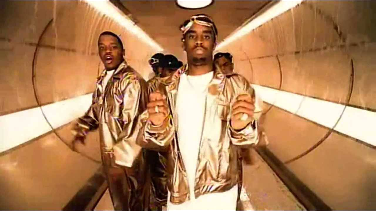 'Honey (Bad Boy Remix)' - This Paul Hunter-directed visual saw Ma$e playing co-pilot alongside Puffy. In a dramatic yet playful helicopter scene, the two rescue Mariah Carey. Adhering to the shiny suit effect, they showed off more of their signature fashion in the indoor golden-tunnel scene. The popularity of the video was the perfect exclamation point to the uber-successful year Ma$e had in 1997. (Photo: Columbia Records)