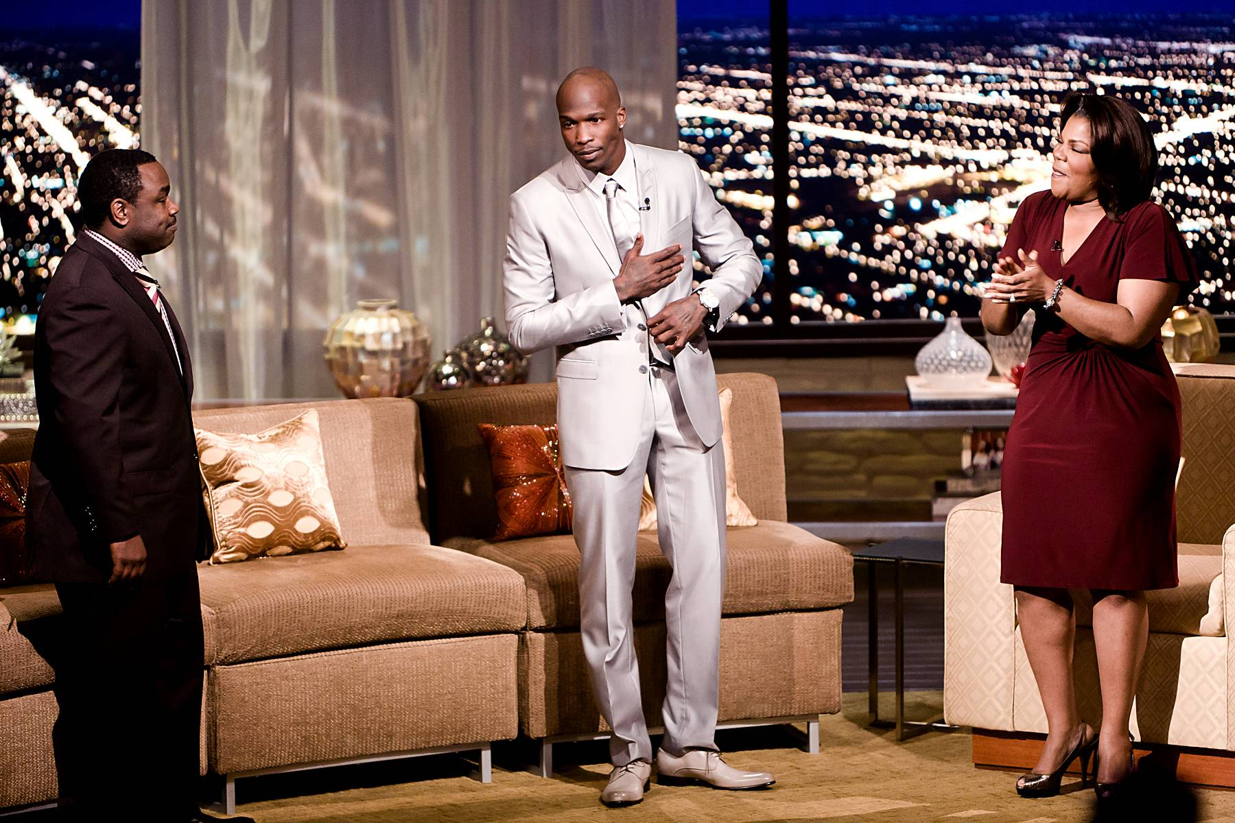 """Where It All Started\r - Ochocinco makes an all-star entrance into the Penthouse. Mo'Nique made sure to compliment the NFL player on his all-gray suit. """"I think Grandma started that--you know where it started at? It started from going to church,"""" said Ochocinco.\r(Photo: Darnell Williams/BET)"""