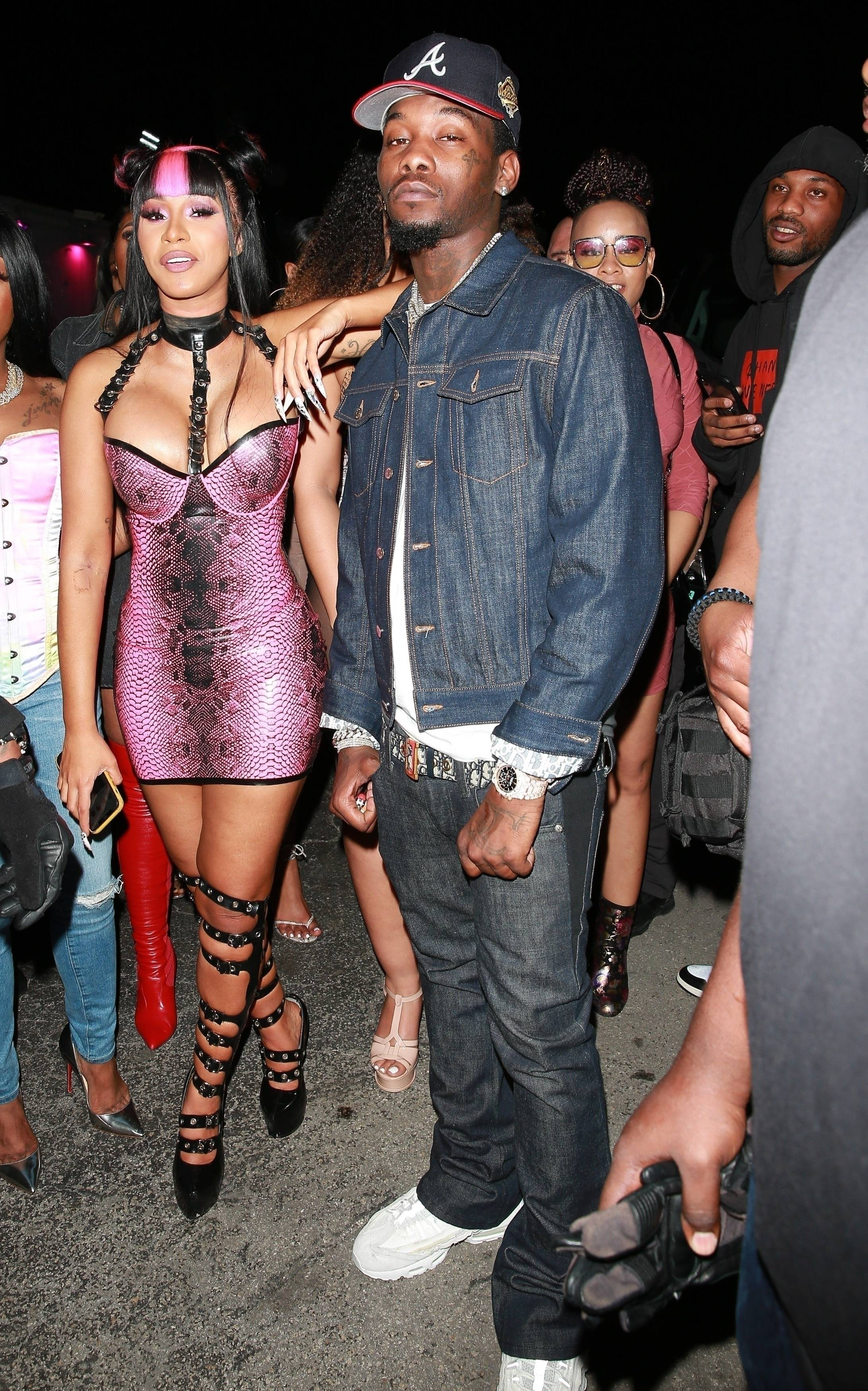 Date Night With Bae - Cardi Band her husband,Offset, caused quite a scene as headed into a Miami strip club last night (Jan. 30). Never one to miss an opportunity to show off her amazing body, the mother of one styled in a skintight pink snakeskin dress with sky-high stilettos to match. Yes, Cardi! And the hair is everything!(Photo: Backgrid) (Photo: Backgrid)