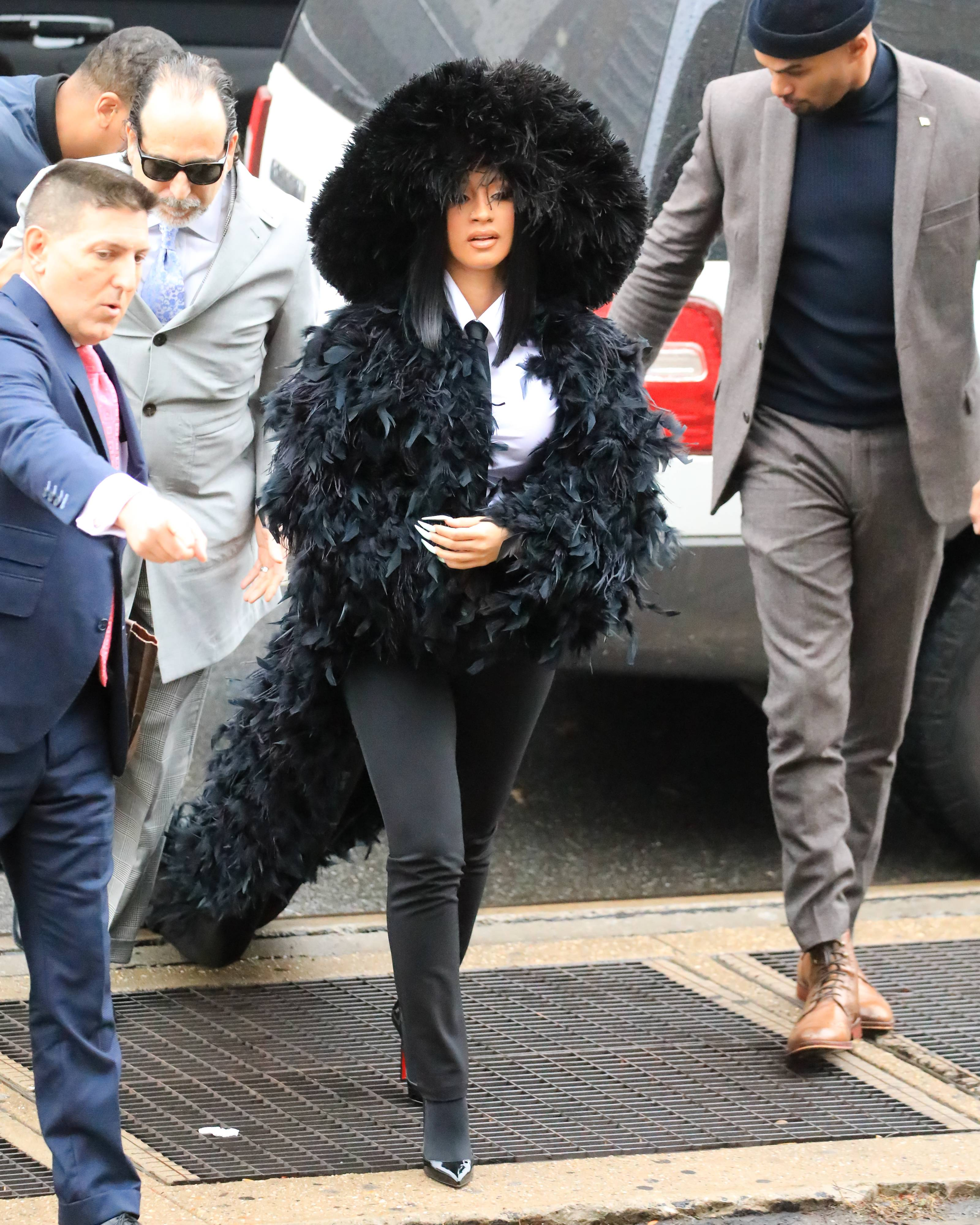 A Queen In Queens - Styled by Kollin Carter, Cardi arrived at court in Queens, NY on Tuesday (Dec. 10) dressed to the nines in ADRIENNE LANDAU's Queen's fur coat designed by Saulo Villela. Talk about making a grand entrance! (Photo: Alessio Botticelli/GC Images)