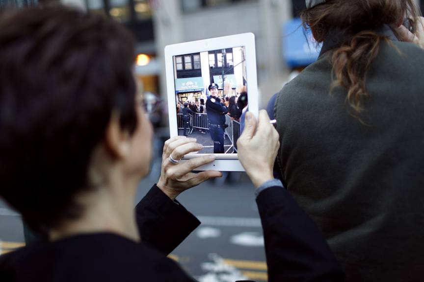 21st Century Protest  - A demonstrator captures scenes of the police near Wall Street. (Photo: Raymond Haddad/BET.com)