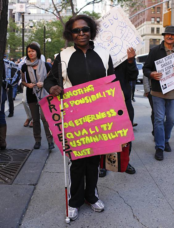 """Time for Equality  - """"As a Black woman, for so long we?ve been deprived of many things: of getting jobs that we know we deserved and of being told there are no more jobs,"""" said April Gail. """"I?m marching today because of the wrongdoing and for the homeless who have lost their homes after paying for them for 10 to 20 years.""""(Photo: Raymond Haddad/BET.com)"""