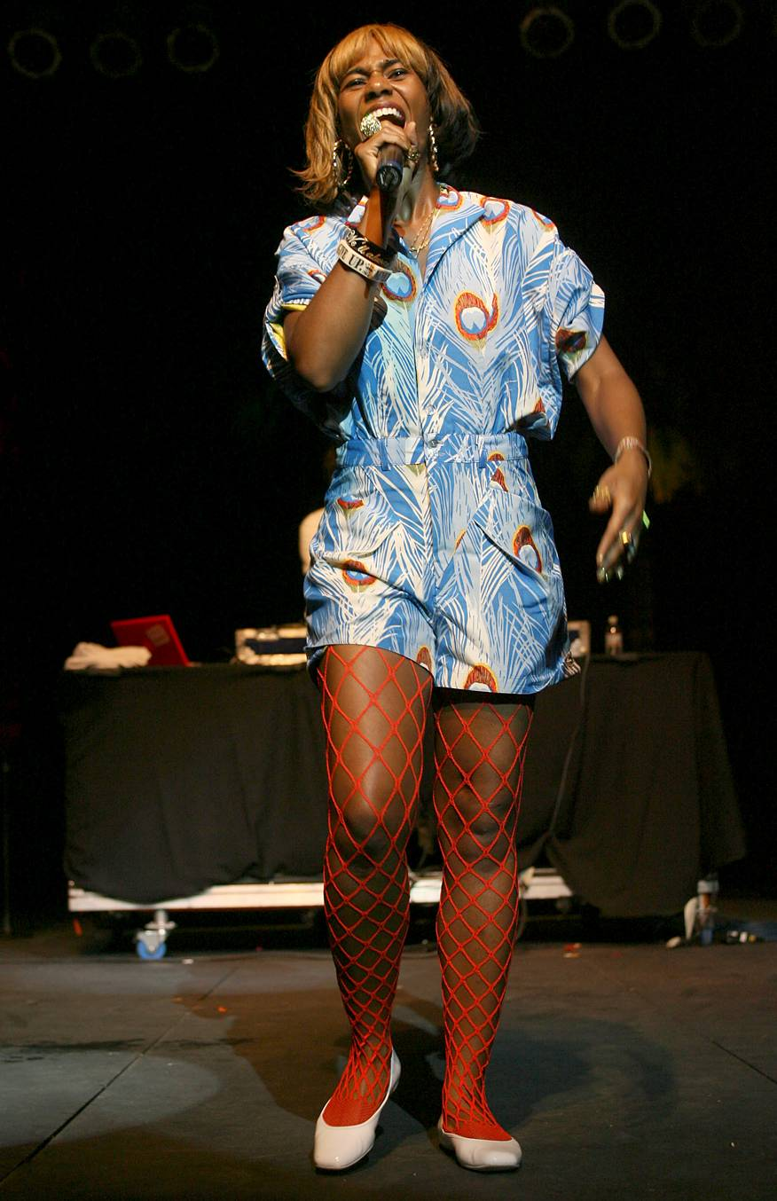 Peacock Central - Santigold is singing her heart out in this picture, but take note of how amazing her peacock print dress it. Work it girl!(Photo: Karl Walter/Getty Images)