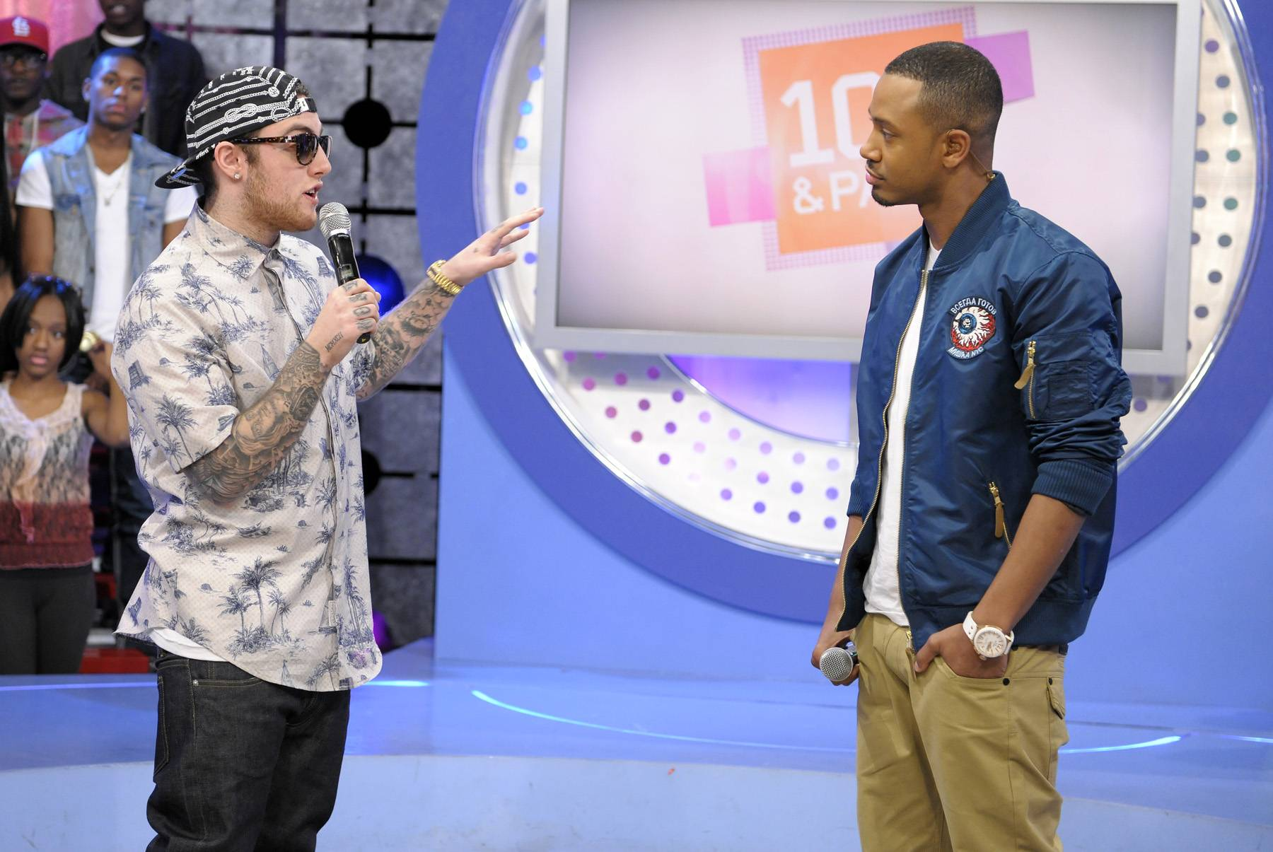 Whoa - Mac Miller talks with Terrence J about balancing having a girl and being in the road, FaceTime, Skype and pictures is how he holds his lady down at 106 & Park, April 26, 2012. (Photo: John Ricard / BET)
