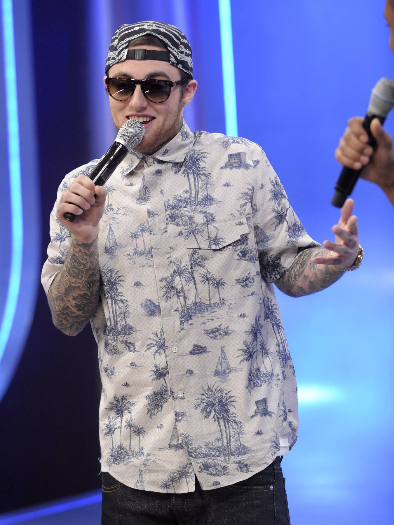 Tell Me - Mac Miller plays Tic Talk with Terrence J where he talked about his tattoos, status as an independent artist and his hometown The Burg at 106 & Park, April 26, 2012. (Photo: John Ricard / BET)