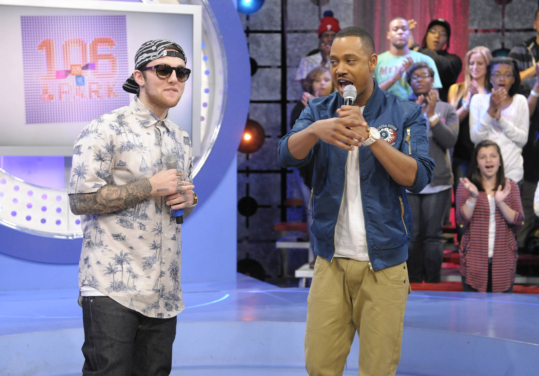 Believe It - Mac Miller tells Terrence J he listened to artists like Outcast and A Tribe Called Quest growing up at 106 & Park, April 26, 2012. (Photo: John Ricard / BET)