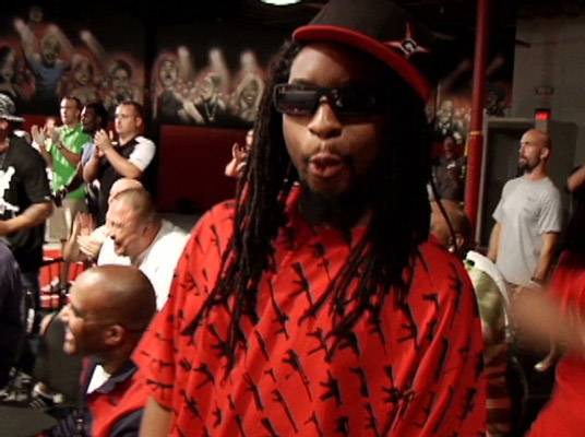 Lil Jon - Is he whistling? No. Lil Jon reacts to some action in the ring.