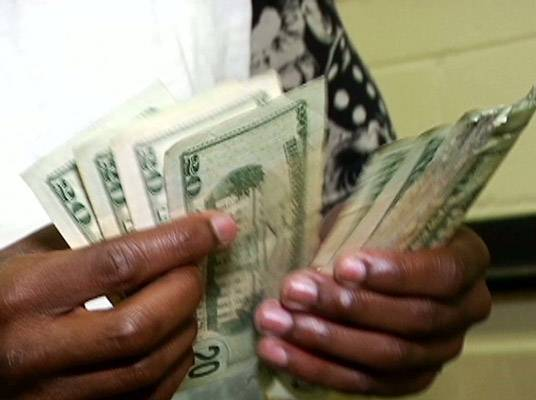 The Money Man - The owner of team Money Mayweather counts his cash.