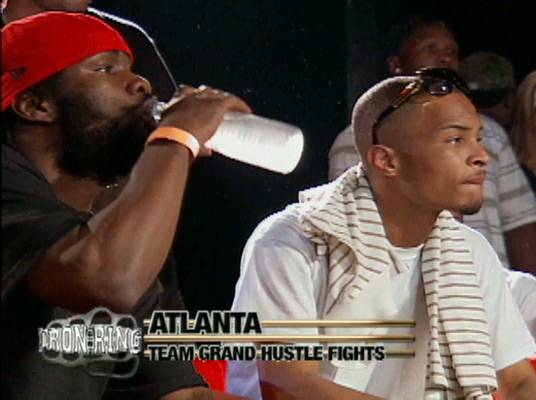 Hustling! - T.I., owner of team Grand Hustle, is on hand to watch the bouts and his team's progress.