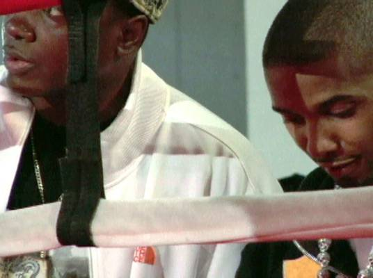Evaluation - Juelz Santana and his team trainer observe and discuss the fighters.