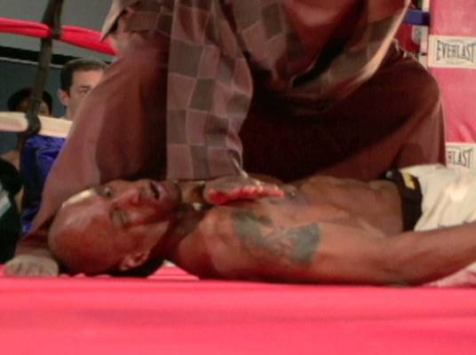 Ouch! - A fighter is hurt after he hits the mat in an awkward position.