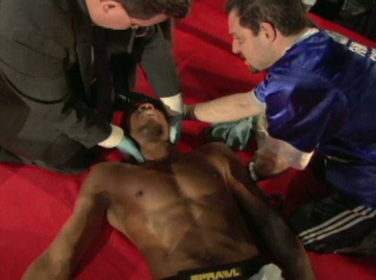 Laid Out - The medics work to assist Derric Strong after he's slammed during his fight.