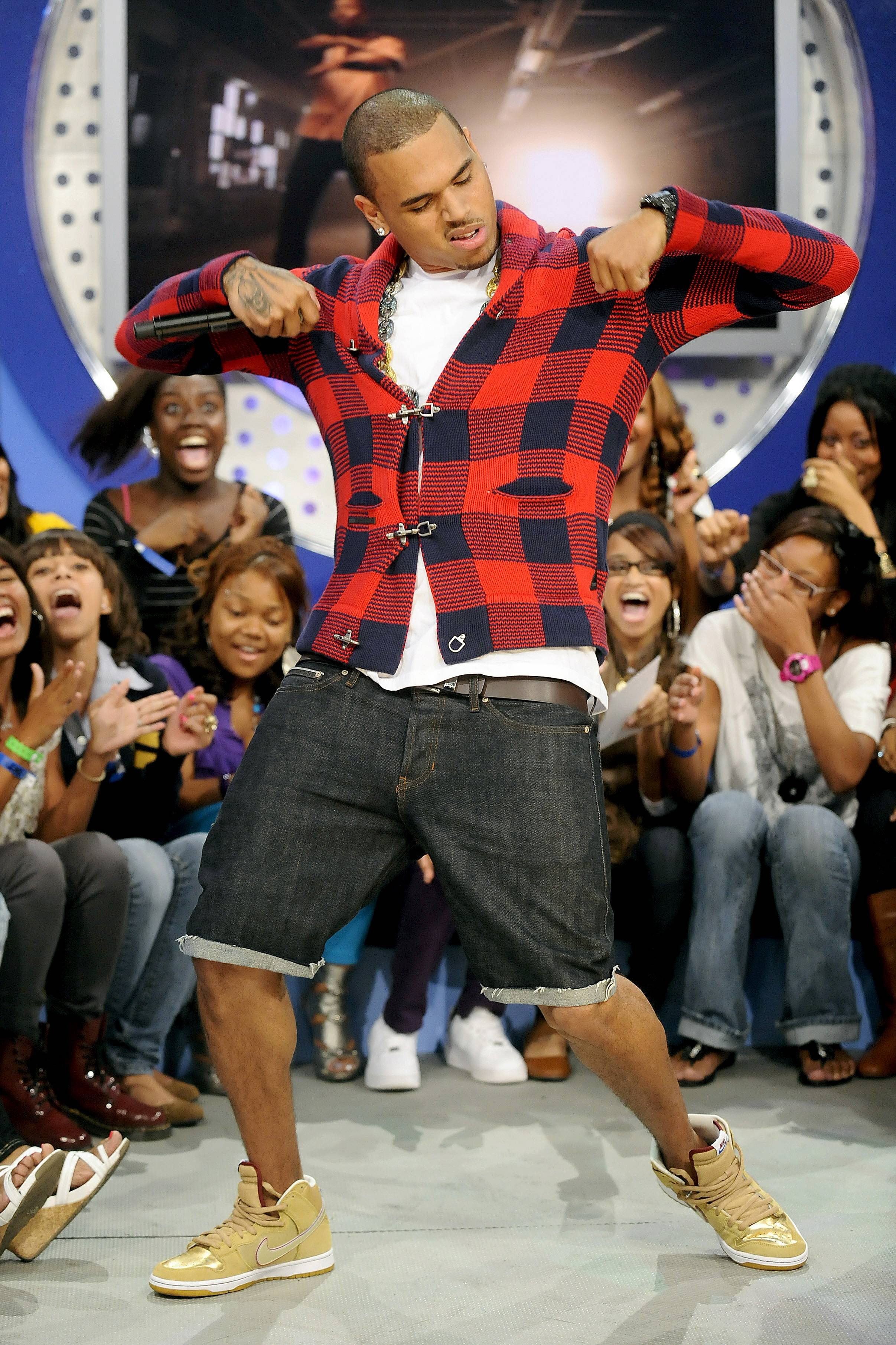 """Plaid and the Dougie - If you ever needed to learn how to """"Dougie,"""" Chris Brown could teach you since he's a certified pro when it comes to the dance.(Photo: Rob Loud/PictureGroup)"""