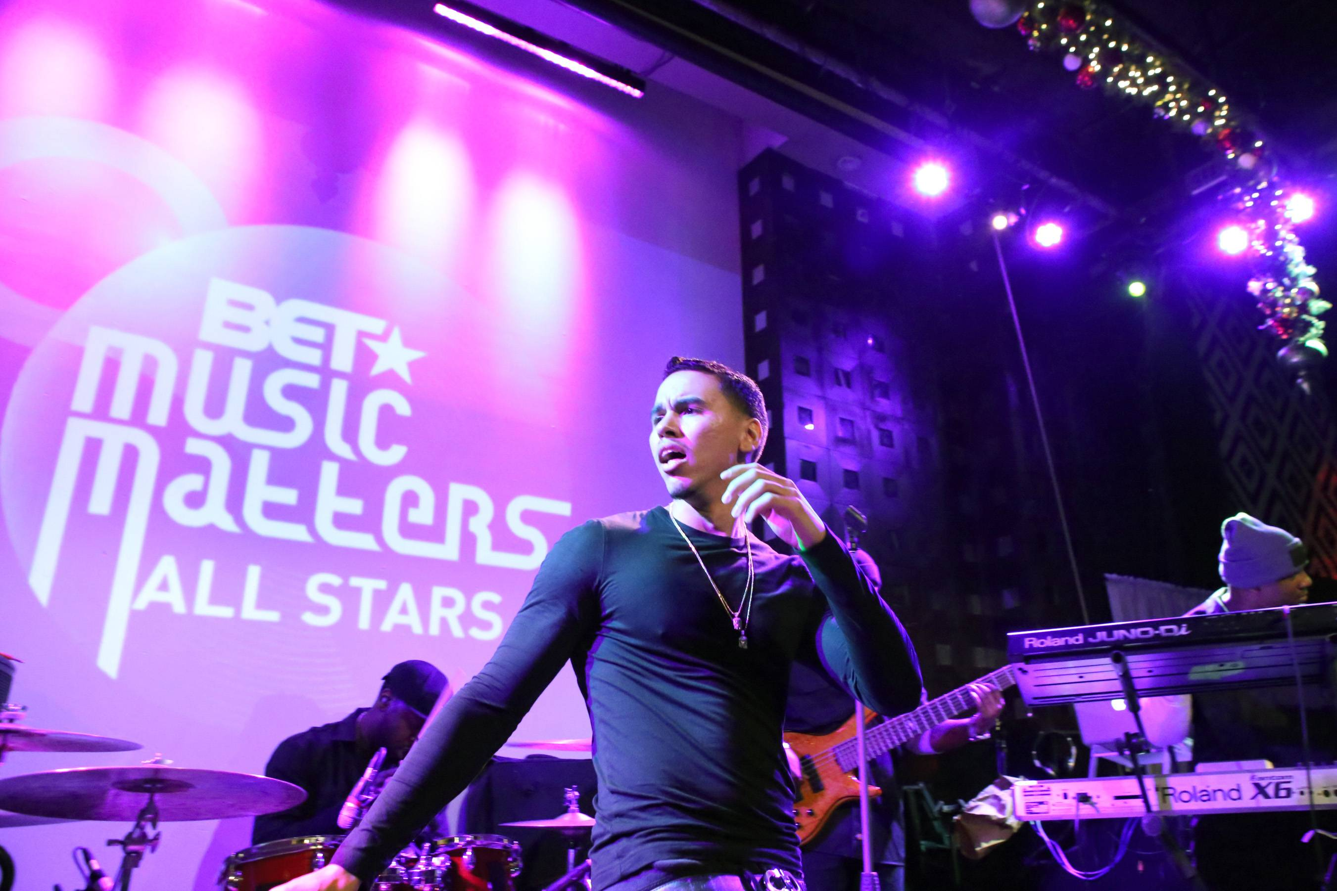 For the People - Adrian Marcel gets into it and the crowd responds. The up-and-coming crooner had a big 2013 and is looking to enjoy an even bigger 2014.(Photo: Bennett Raglin/BET/Getty Images for BET)