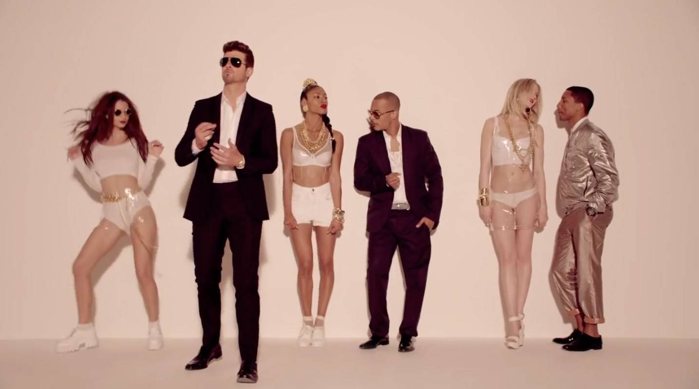 """Robn Thicke ft. T.I. and Pharrell Williams - """"Blurred Lines"""" - It wasn't hard to see why this song was a hit!  (Photo: Star Trak)"""