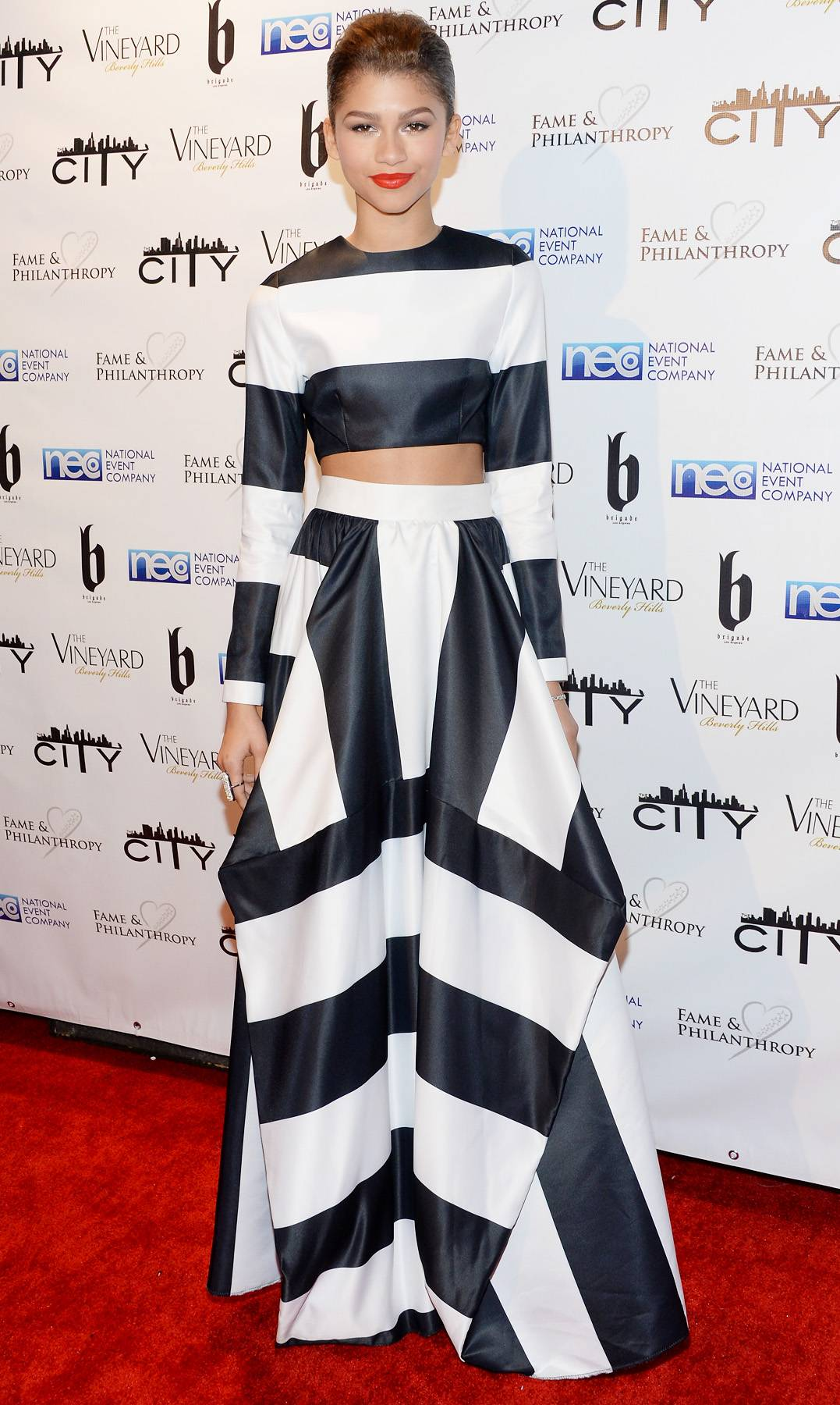 Bold and Beautiful - The young starlet knows what flatters her frame and this Nicci Houstriped crop top and full skirt does wonders.  Get into the trend: coordinating tops and bottoms in the same pattern with just a hint of tummy showing.  (Photo: Jason Kempin/Getty Images)