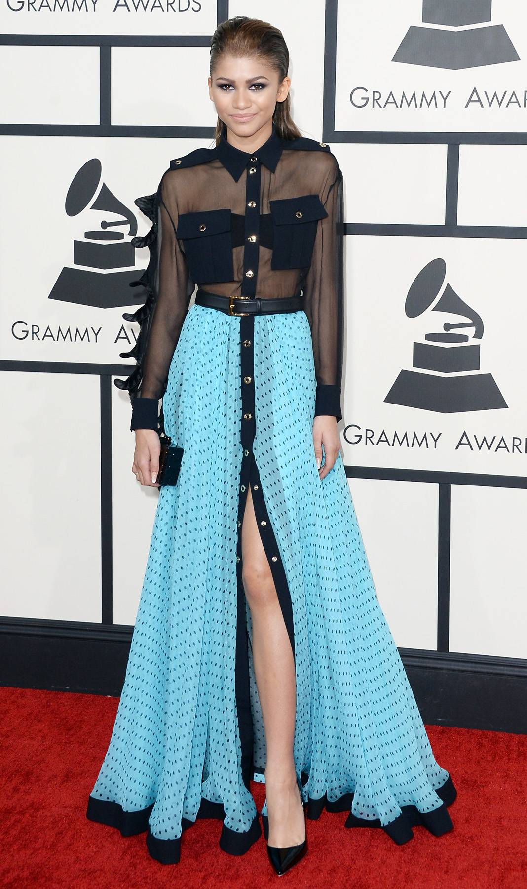 Sheer Darling - A little sheer plus a flowing, polka-dot skirt is pure magic on the red carpet, while her slicked-back 'do adds a touch of sophistication.   (Photo: Jason Merritt/Getty Images)