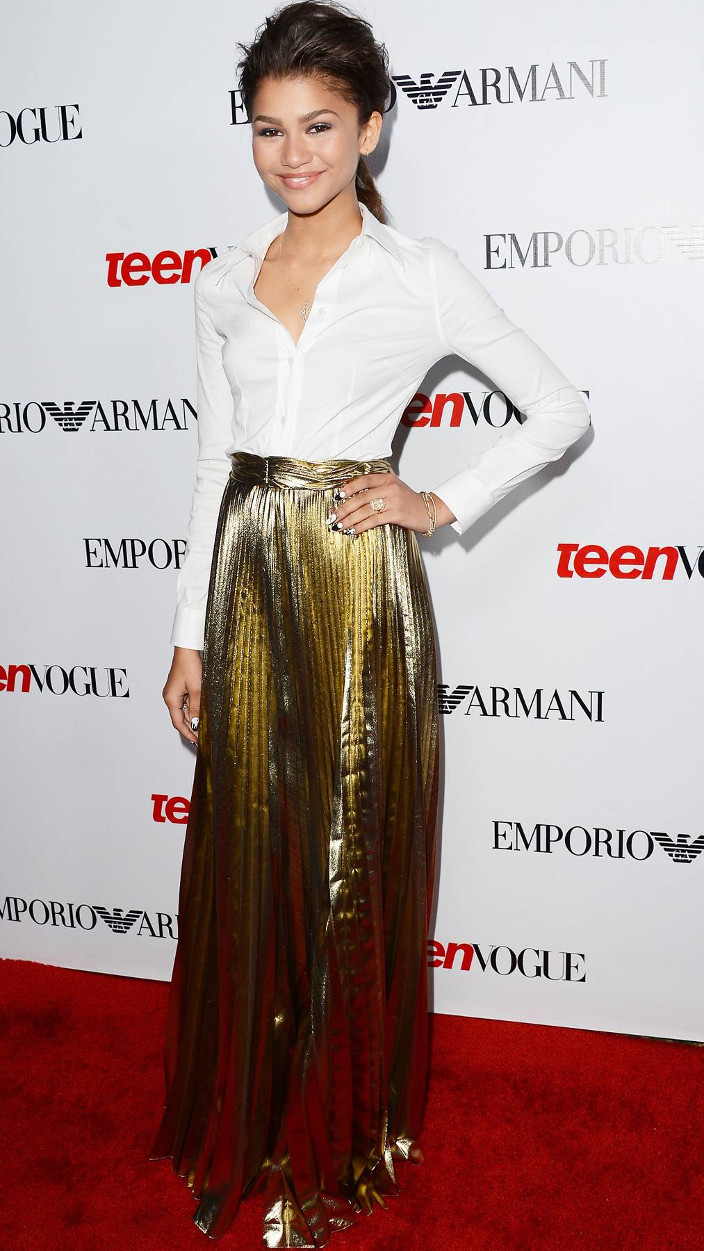 Golden Girl - Another thing to love about Zendaya is that she's glamorous without ever showing too much. We'd never think to pair a crisp, white button-down and with a metallic skirt, but the overall look is young and polished.(Photo: Jason Merritt/Getty Images)