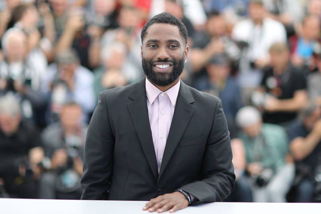 John David Washington - When you're the son of Denzel Washington, it's inevitable that people will compare your acting skills to those of your father. Fortunately, John David, 36, doesn't disappoint. The former football pro starred in Christopher Nolan's sci-fi thriller, Tenet, the first major movie to be released during the pandemic. The film grossed $300 million worldwide, cementing Washington's status as a huge star, in his own right. (Photo by VALERY HACHE/AFP via Getty Images)