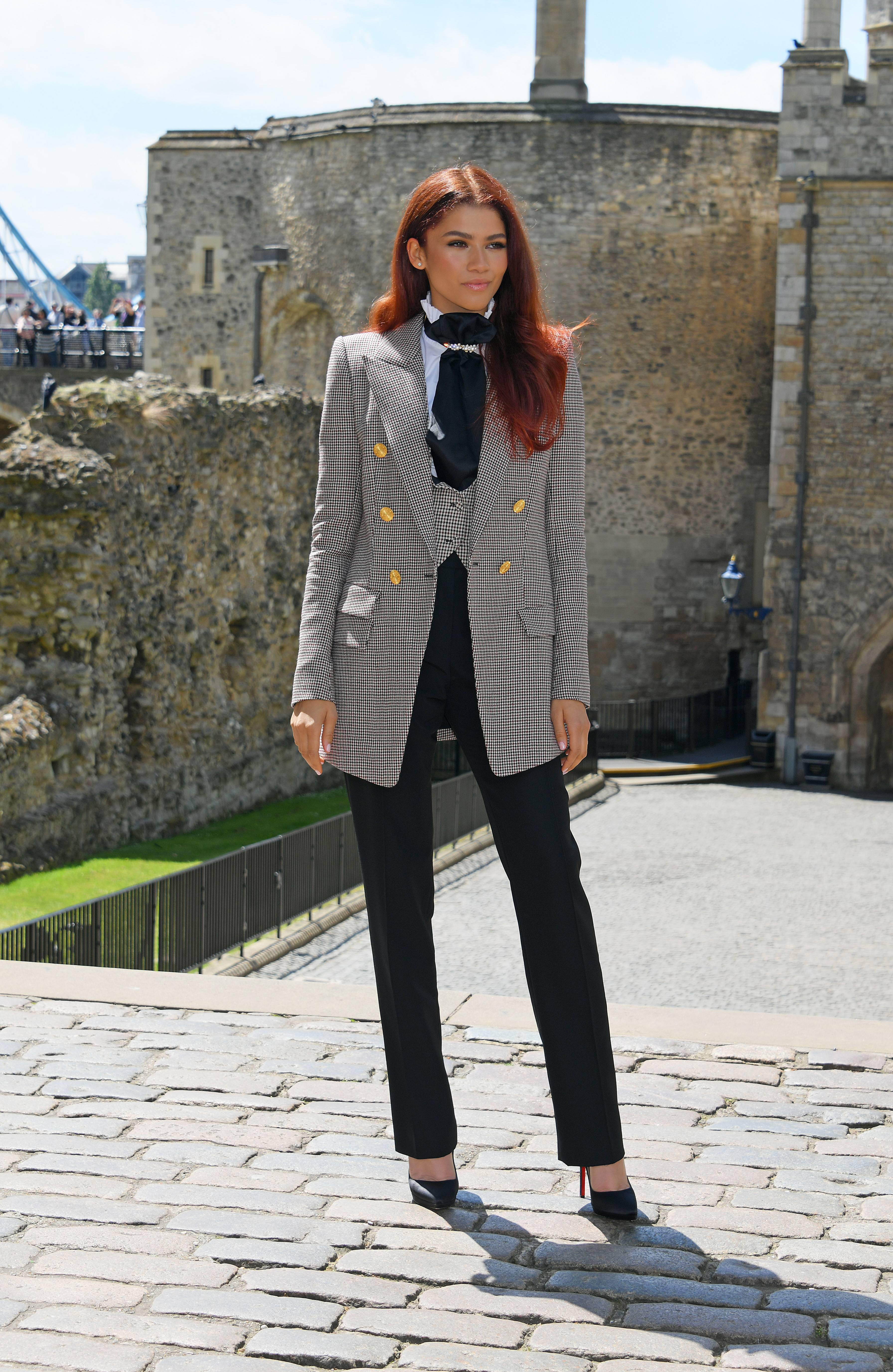 Mary Jane Does London - The London Bridge definitely came down to make way for Zendaya's slay! The leading lady of Spiderman: Far From Home debuted a brand new 'do to fit right in with her character. While we definitely loved her hair, we can't get over this London-inspired, FTW Alexandre Vauthier 'fit of a houndstooth blazer and vest, black pencil trousers paired with Louboutin pumps that she was rocking! (Photo: David M. Benett/Dave Benett/WireImage)