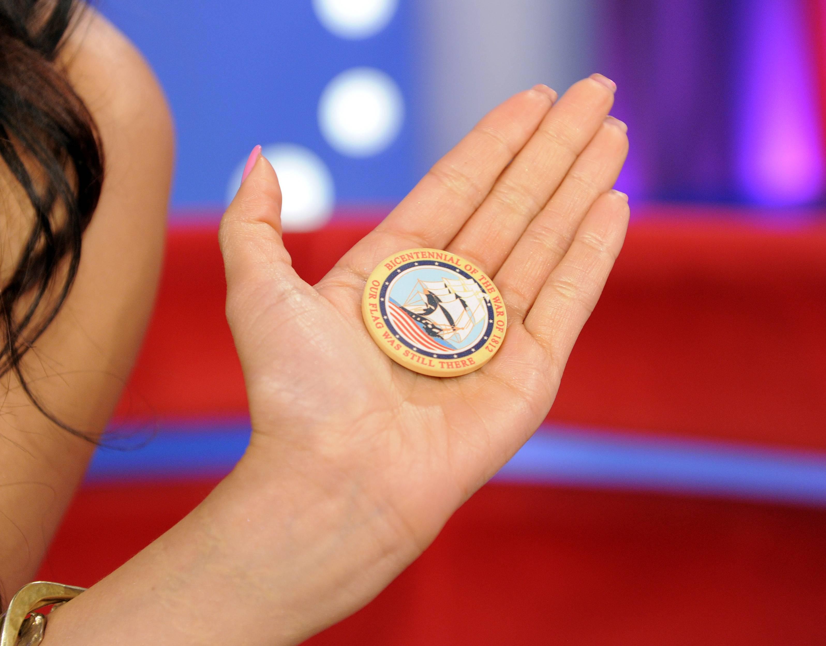 Nice - A US Marine presents Rocsi Diaz with a token of their appreciation at 106 & Park, May 29, 2012. (Photo: John Ricard / BET)