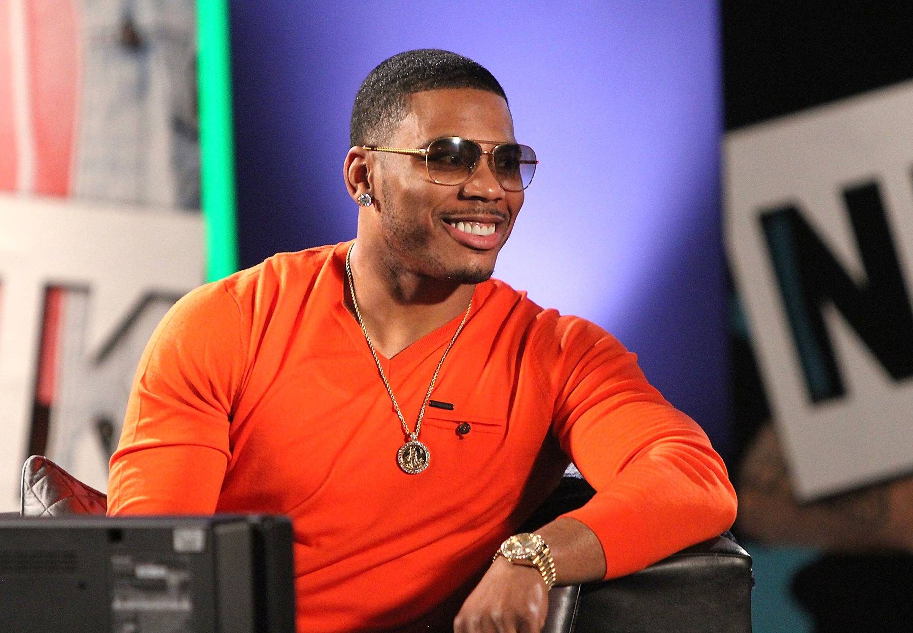 Money Shot - Nelly flashes his dope smile one time.  (Photo: Maury Phillips/WireImage)