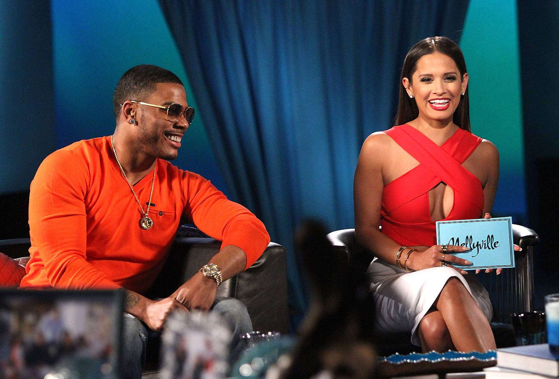 'Let the (Great) Times Roll' - Nelly and Rocsi Diaz can't stop laughing. (Photo: Maury Phillips/WireImage)