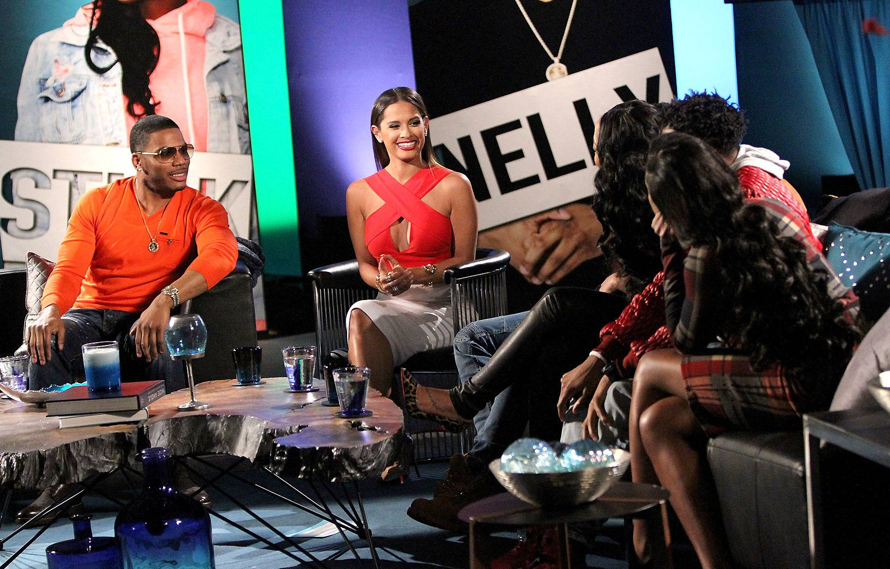 Lean In - The Nellyville clan leans in while Rocsi talks. (Photo: Maury Phillips/WireImage)