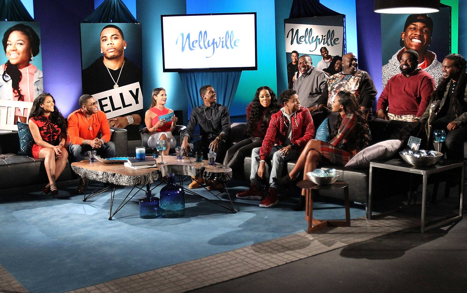 Precious Moments - The Nellyville clan share a laugh at the reunion.   (Photo by Maury Phillips/WireImage)